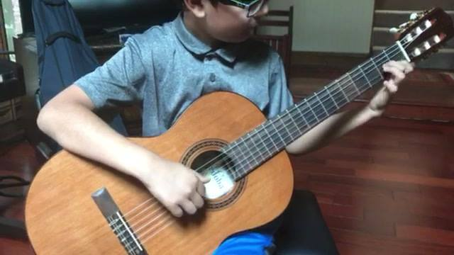 My 10 yr old student, Satvik tearing it up on Carcassi Etude in A minor. His tremelos are coming along nicely. Still a l...