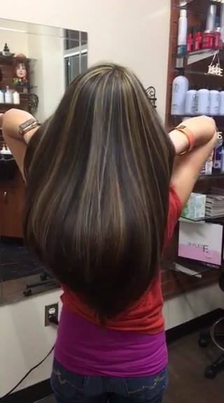 Caramel highlights over dark brown with longer layers it's beautiful . Call or text me : 571-243-4618 or Email me : chik...