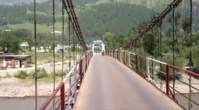 Car is crossing the bridge At Kunhar River Kaghan Valley
